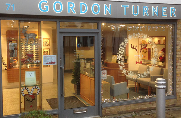 Gordon Turner Optometrists' shop front window with Christmas decorations