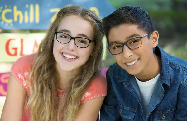 Happy teenage girl and boy both wearing Rock Star branded glasses.