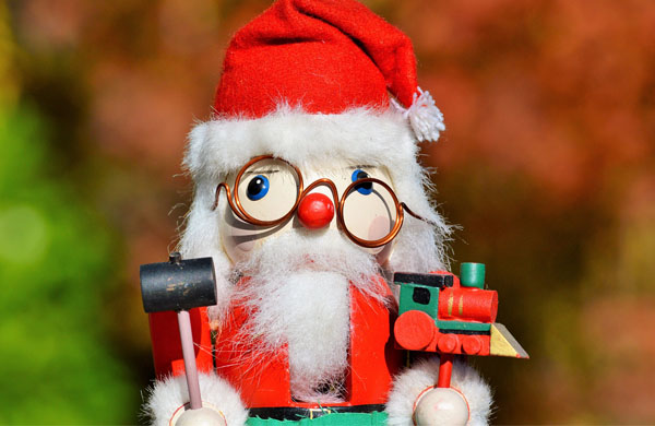 Santa wooden toy with wonky spectacles